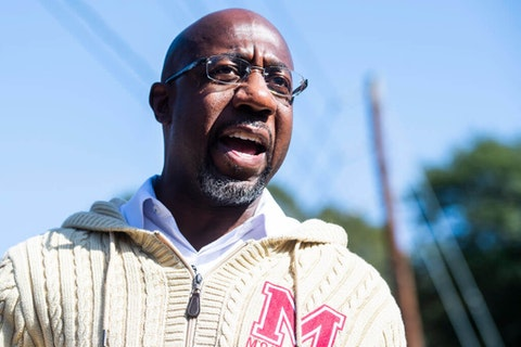 Rev. Raphael Warnock, Democratic candidate for Georgia senate, speaks with supporters during a campaign stop near Coan Park in Atlanta, Ga., on Tuesday, November 3, 2020. (Photo By Tom Williams/CQ-Roll Call, Inc via Getty Images)