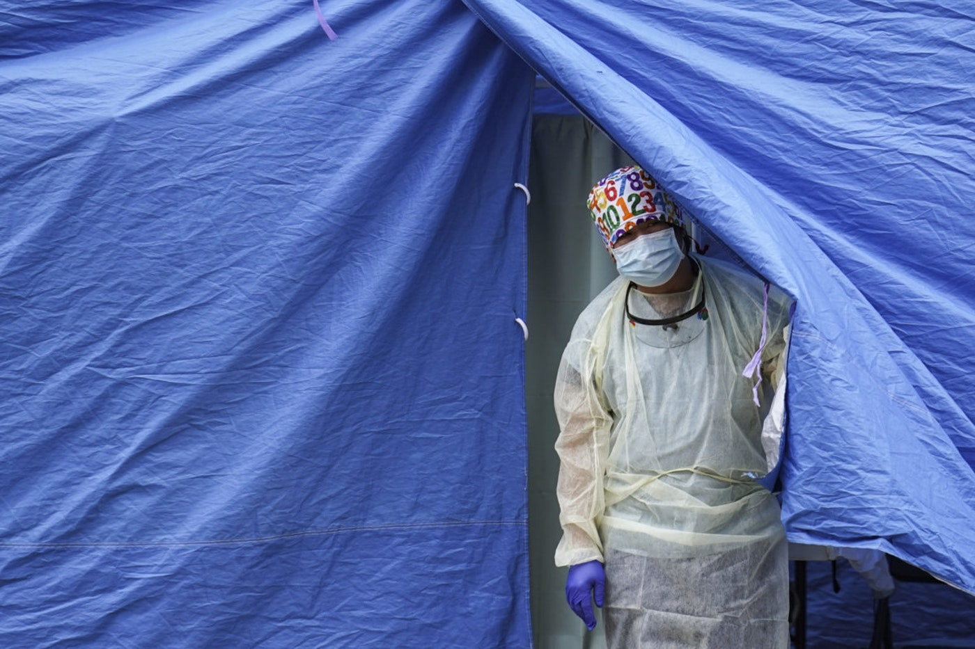 In this Nov. 11, 2020, file photo, medical workers operate a testing tent at a COVID-19 mobile testing site  in the Brooklyn borough of New York. (AP Photo/John Minchillo, File)