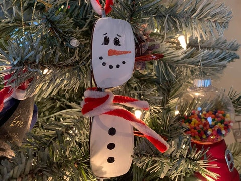 Christy Hester of Twin Lake turned her late husband's glasses into a snowman ornament.