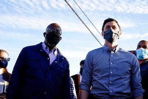 Jon Ossoff and Raphael Warnock wearing masks