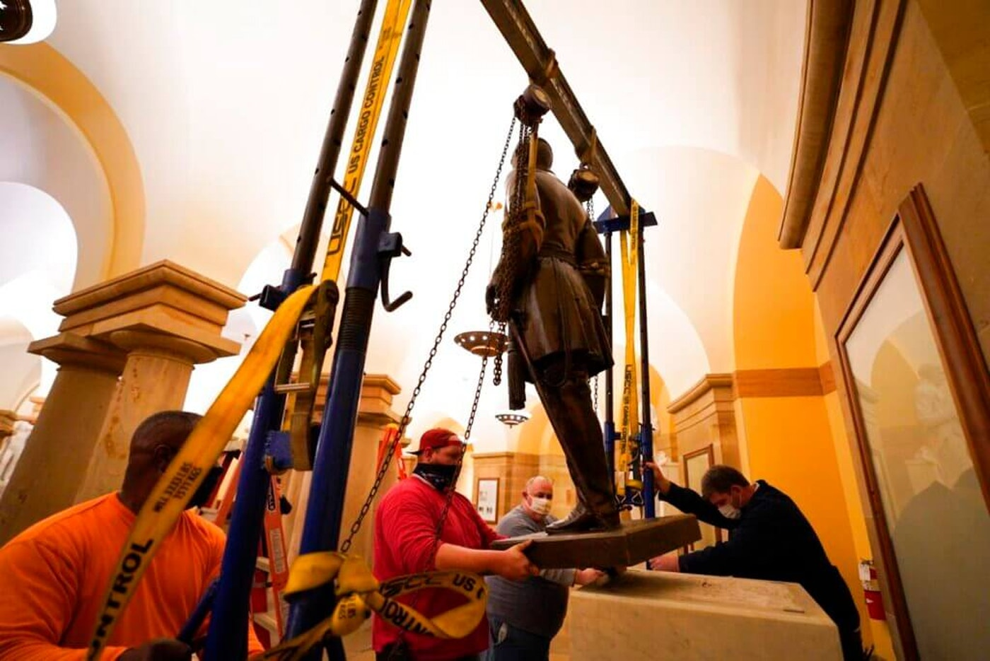 workers in the Capitol building removing a confederate statue to replace it with civil rights icon Barbara Johns