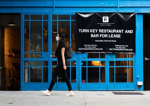 A person walks by a restaurant that went out of business in Gramercy as the city continues the re-opening efforts following restrictions imposed to slow the spread of coronavirus on October 21, 2020 in New York City. The pandemic continues to burden restaurants and bars as businesses struggle to thrive with evolving government restrictions and social distancing plans which impact keeping businesses open yet challenge profitability. (Photo by Noam Galai/Getty Images)