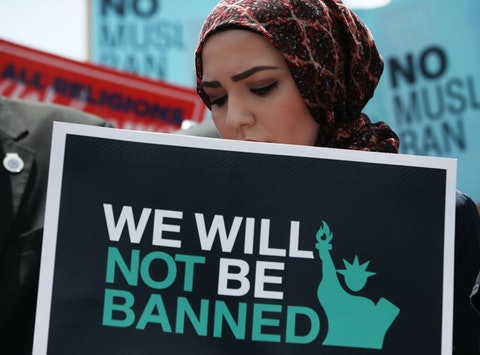 A women participates in demonstration against  President Trump's travel ban as protesters gather outside the U.S. Supreme Court. (Photo by Mark Wilson/Getty Images)