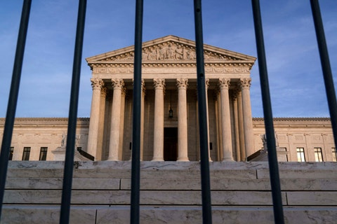 In this Nov. 5, 2020, file photo, the Supreme Court in Washington. The Supreme Court has rejected Republicans' last-gasp bid to reverse Pennsylvania's certification of President-elect Joe Biden's victory in the electoral battleground. The court without comment Tuesday, Dec. 8, refused to call into question the certification process in Pennsylvania. (AP Photo/J. Scott Applewhite)