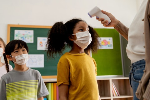 COVID vaccines will not be available to children in time for them to return to school next year. Image via Shutterstock