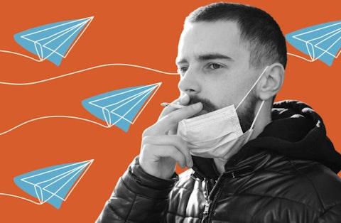 An unidentified man smokes a cigarette during the coronavirus pandemic. (Shutterstock Photo/Sergii Sobolevskyi)