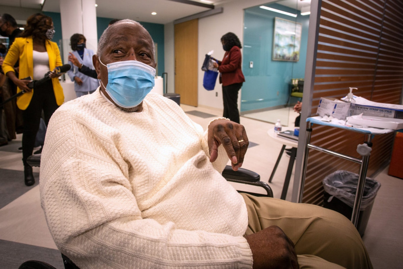 Baseball Hall of Famer Hank Aaron waits to receive his COVID-19 vaccination on Tuesday, Jan. 5, 2021, at the Morehouse School of Medicine in Atlanta. (AP Photo/Ron Harris)