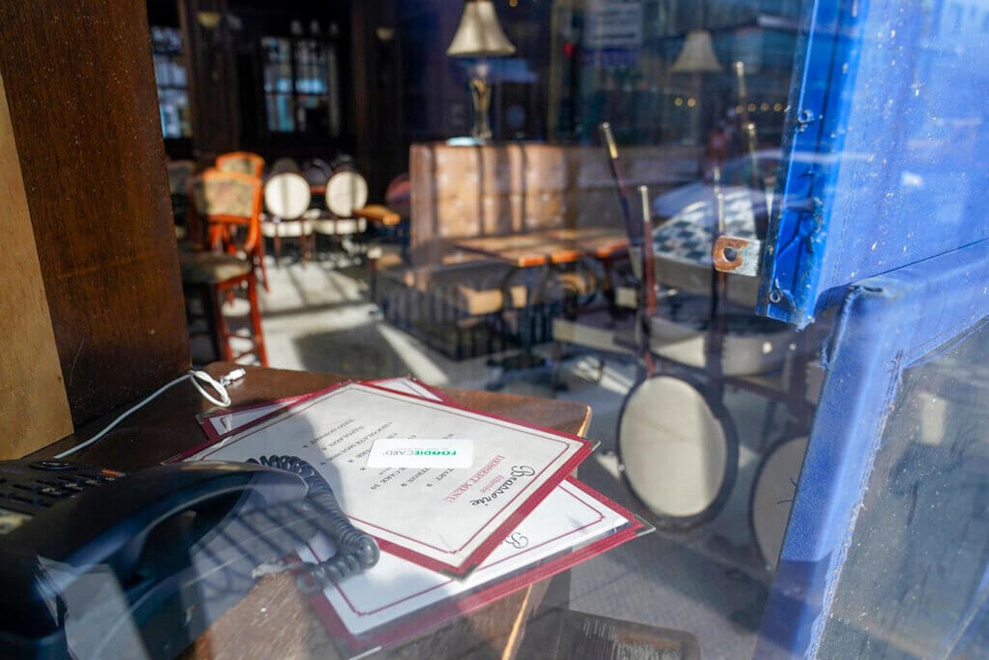 menus at a restaurant closed due to COVID shutdowns