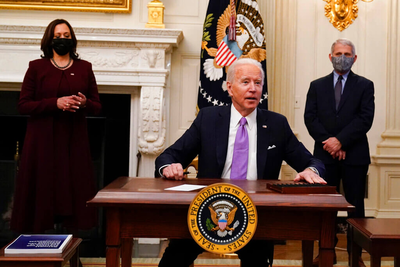 Joe Biden signed executive orders marking the start of his COVID plan for the nation