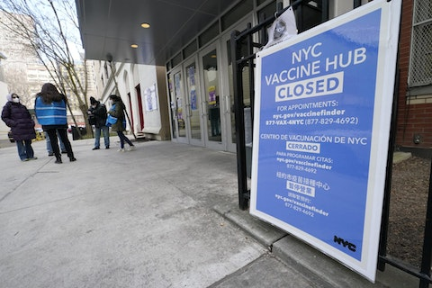 In this Jan. 21, 2021, file photo, people who had appointments to get COVID-19 vaccinations talk to New York City health care workers outside a closed vaccine hub in the Brooklyn borough of New York after they were told to come back in a week due to a shortage of vaccines. (AP Photo/Kathy Willens)