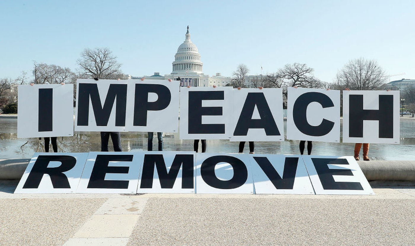 People gather at the base of the U.S. Capitol with large IMPEACH and REMOVE letters on January 12, 2021 in Washington, DC. The group is calling on Congress to impeach and remove President Donald Trump on the day that Democrats introduced articles of impeachment in response to Trump's incitement of a mob entering the U.S. Capitol Building on January 6. (Photo by Paul Morigi/Getty Images for MoveOn)