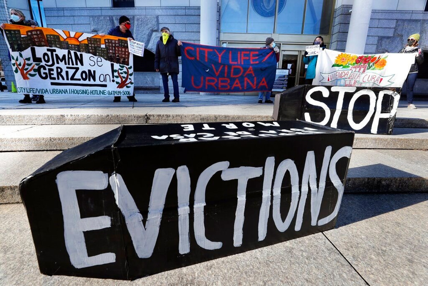Tenants' rights advocates demonstrate in front of the Edward W. Brooke Courthouse in Boston on Jan. 13. ( Image via AP/Michael Dwyer)