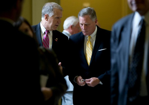 Sen. Thom Tillis, R-N.C., left, and Sen. Richard Burr, R-N.C., right, walk from a policy luncheon on Capitol Hill in Washington, Wednesday, July 8, 2015. (AP Photo/Carolyn Kaster)