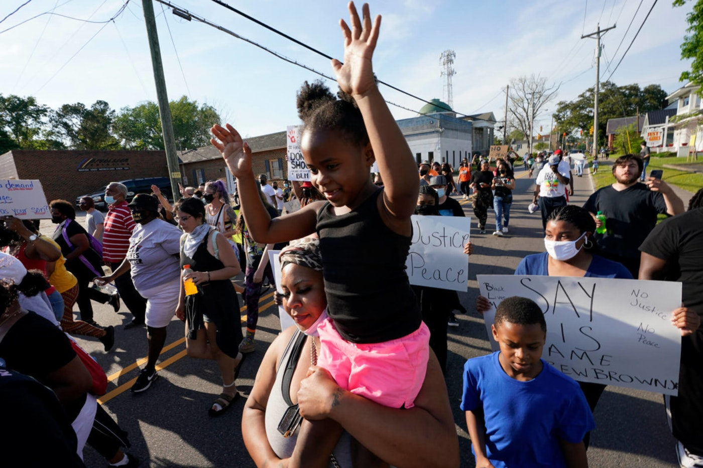 Protesters march along the streets to protest the shooting of Andrew Brown Jr. in Elizabeth City, N.C., Wednesday, April 28, 2021. On Wednesday, 85 days after Brown's shooting, the family filed a federal lawsuit, claiming they could not get justice in North Carolina state courts from local officials. (AP Photo/Steve Helber)