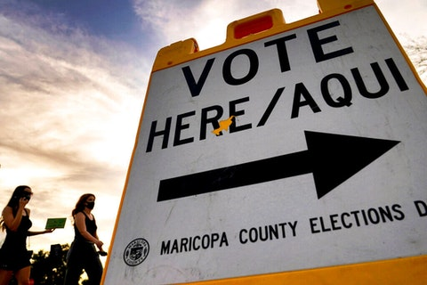 """close up of """"Vote Here"""" sign"""