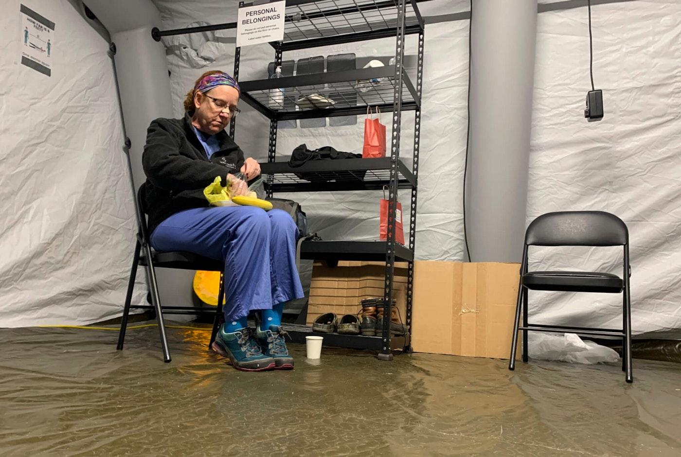 Chris Rutledge, a nurse for Samaritan's Purse, eats lunch in January 2021 during the only short break of her 12-hour shift inside the COVID-19 field hospital in Lenoir, N.C. (AP Photo/Sarah Blake Morgan)
