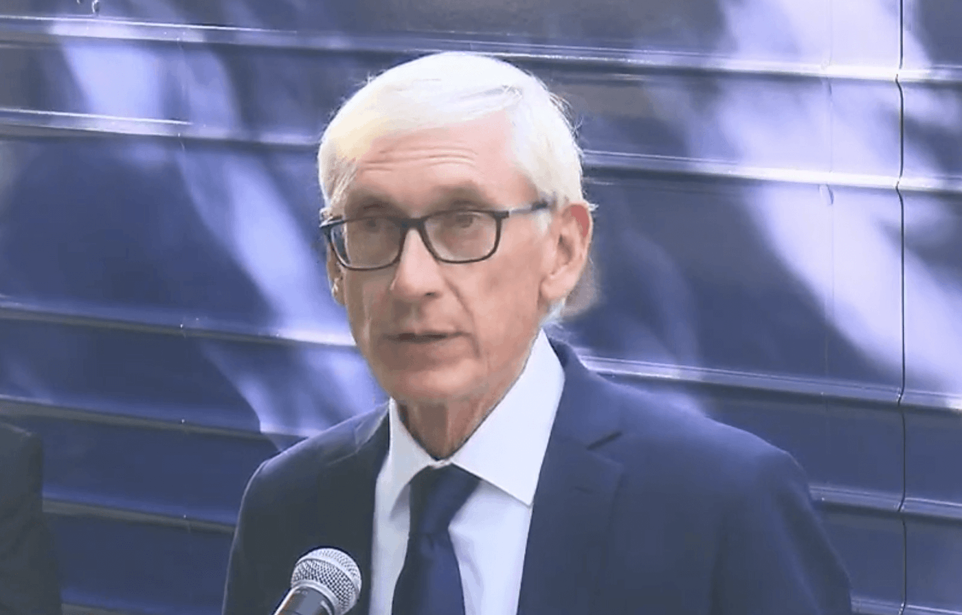 """Gov. Tony Evers, speaking during an event hosted by the Democratic Party to promote President Joe Biden's agenda, said Republicans are spreading """"dog whistle crap"""" when they raise baseless concerns about whether Afghan refugees are being vetted before coming to Fort McCoy. (Screenshot via WisEye)"""
