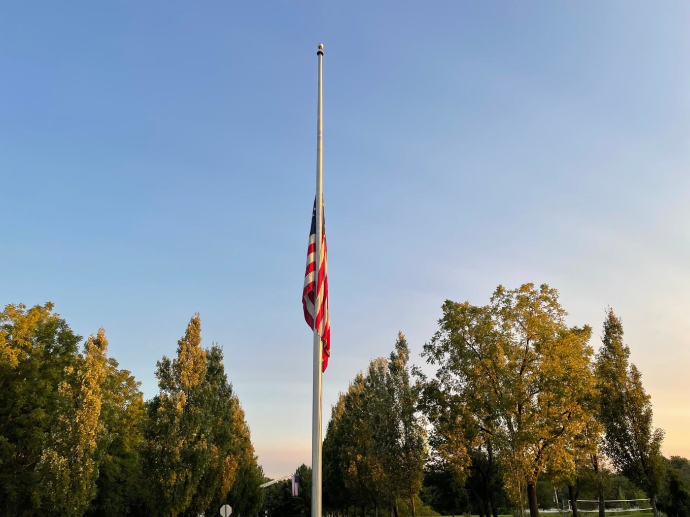 The 9/11 Tribute Flag flies at half-mast over the Garden of Reflection 9/11 Memorial in Bucks County. Three pilots, who were friends with United Airlines Flight 175 pilot Victor Saracini, have taken the flag on flights over each of the crash sites. The 9/11 Tribute Flag is believed to be the only flag that has flown in the air above all three crash sites. (Keystone Photo/Patrick Berkery)