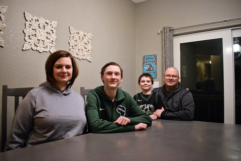 The Abbott family of Slinger (from left, Becky, Aidan, Ryder and Tom) is fighting for the passage of the federal Ensuring Lasting Smiles Act, or ELSA. The bill would require insurance companies to pay for medically necessary procedures related to congenital anomalies, or birth defects. Insurance companies have repeatedly denied coverage of treatment for Aidan, who was born without most of his teeth due to a form of ectodermal dysplasia. (Photo by Jonathon Sadowski)