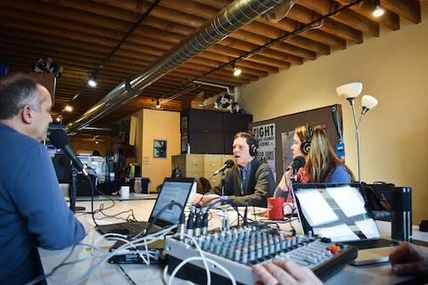 "At center, Robert Kraig, executive director of Citizen Action of Wisconsin, speaks during a recording of the weekly progressive podcast ""Battleground Wisconsin."" (Photo by Jonathon Sadowski)"
