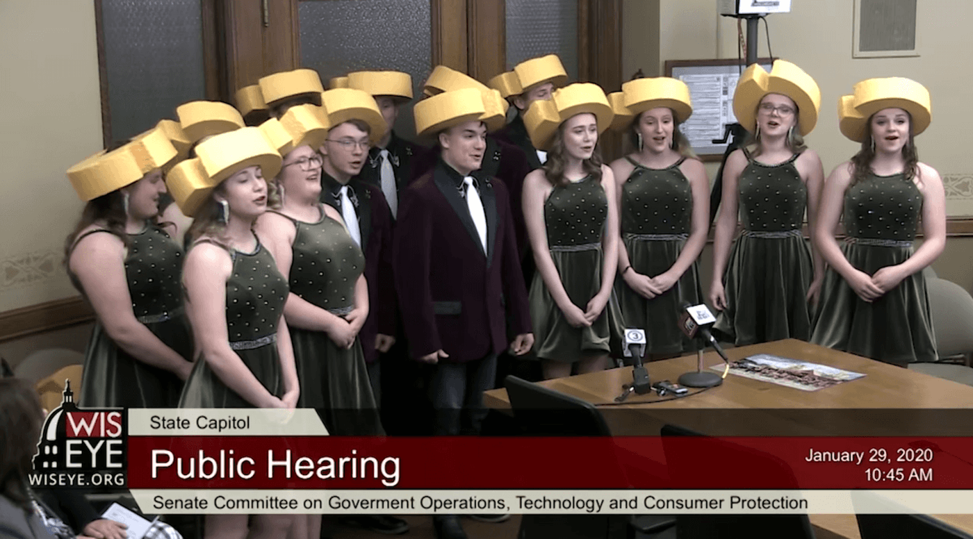 Members of the Colby High School choir perform a song praising their city's namesake cheese before a legislative committee (Image from video provided by WisconsinEye)