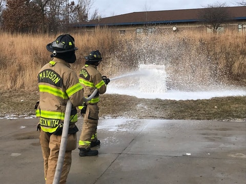 Madison firefighters spray PFAS-free foam during a media demonstration earlier this year. The PFAS-free foam is an alternative to the foam produced at the Tyco plant in Marinette. (Photo by Madison Fire Department)