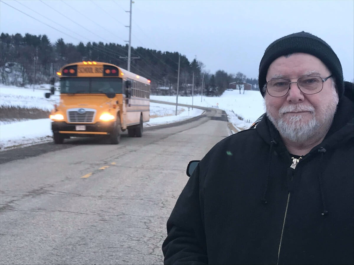 Denis Olson of Blanchardville braves the car-rattling ride on Iowa County Trunk Highway F every day on his drive to work in Barneveld. (Photo by Susan Lampert Smith)