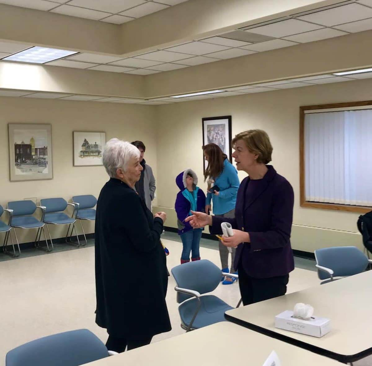 Sen. Tammy Baldwin talks to a constituent in Stevens Point during a meeting about prescription drug prices. (Photo courtesy of Sen. Baldwin Facebook page)