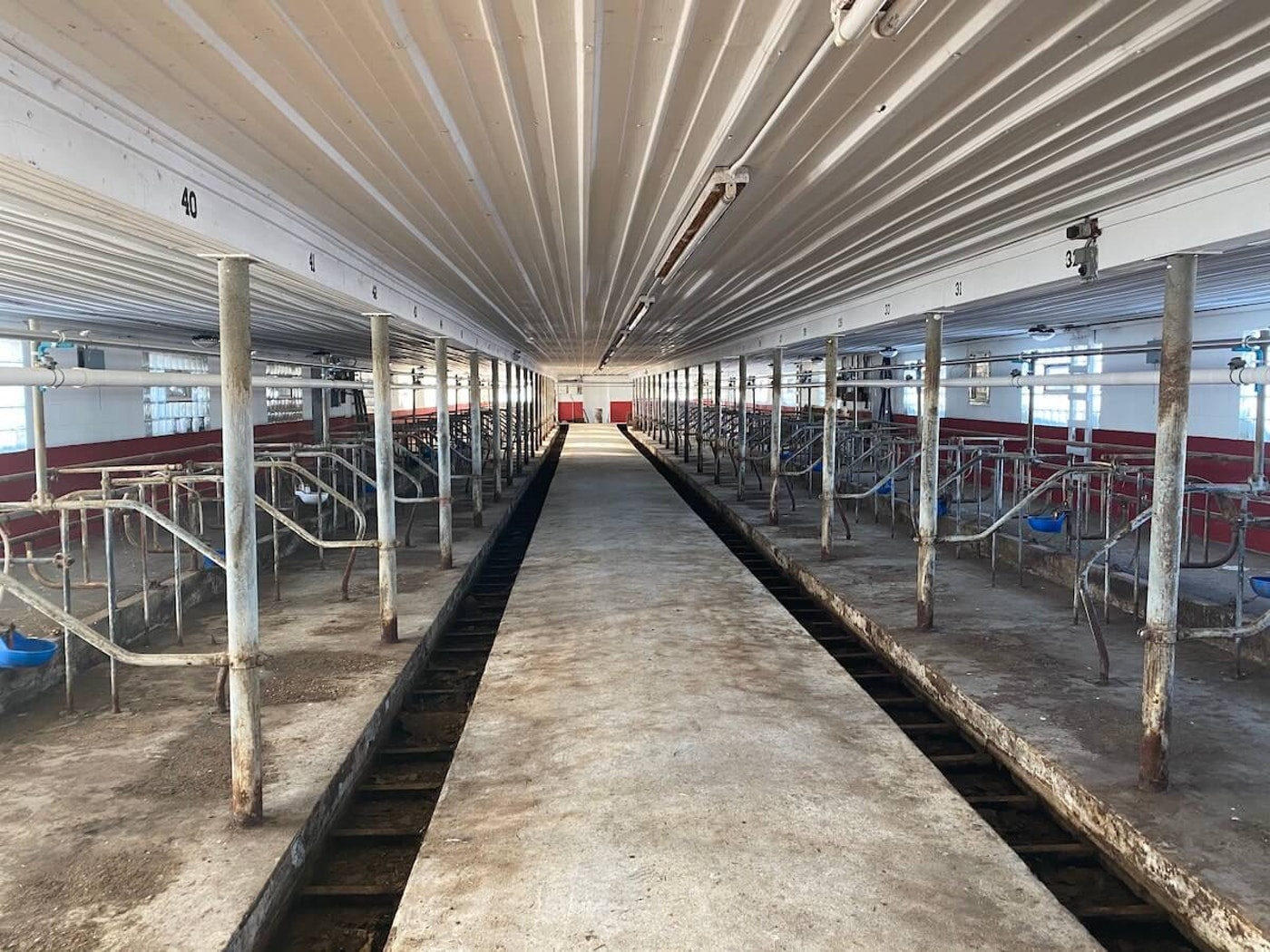 This barn in Manitowoc County sits empty after hosting four generations of a family that milked 72 cows twice a day. (Photo by Pat Kreitlow)
