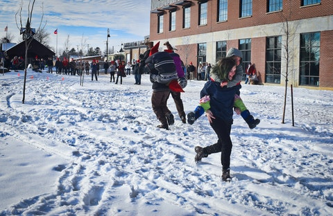 Participants hurry during the first-ever Partner Carry race at Mount Horeb's Scandihoovian Fest.  (Photo by Jonathon Sadowski)