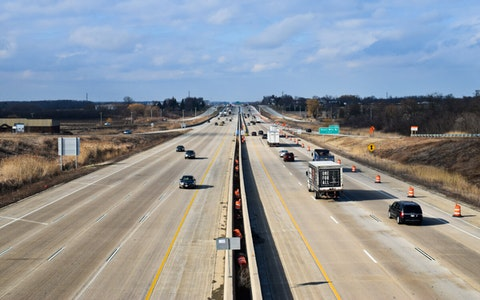 Vehicles drive Monday on Interstate 94 in the Kilbornville area of the Village of Caledonia in Racine County. The location is one of the data collection points the Wisconsin Department of Transportation says has seen much reduced traffic since Gov. Tony Evers declared a health emergency due to coronavirus. (Photo by Jonathon Sadowski)