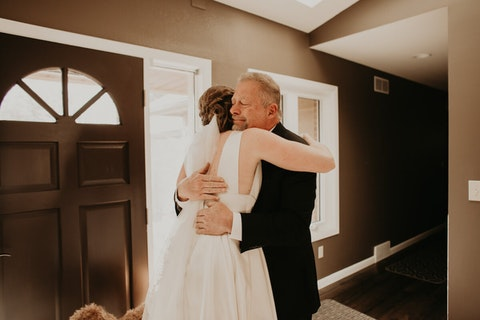 Jeff Hare of Menomonee Falls hugs his daughter, Nikki Michler, on her wedding day in December. (Photo by Citrine Pine Photography)