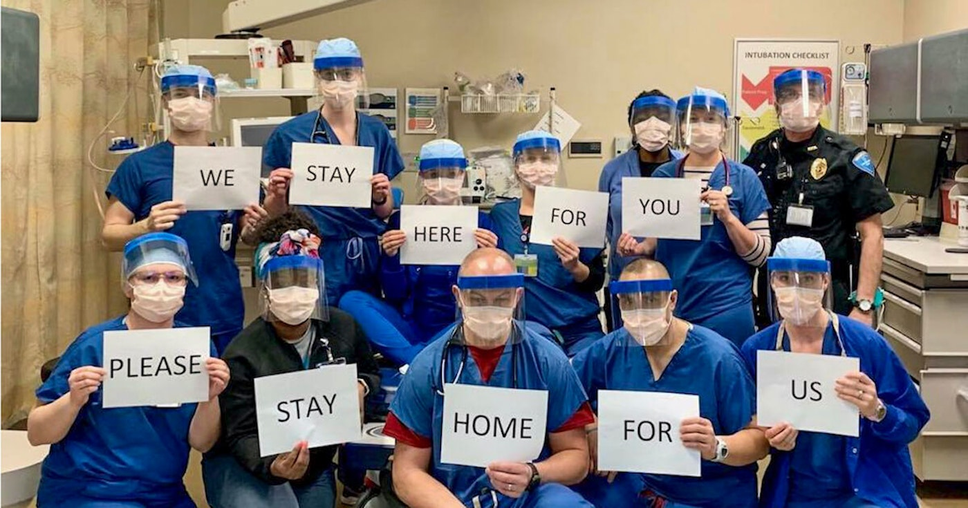 Emergency department medical staff at Meriter Hospital in Madison with a message for the public back in March. (Photo provided)