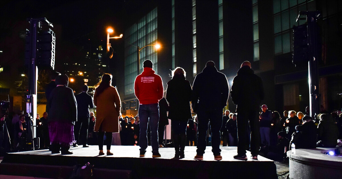 Speakers from various nonprofits, churches, and political groups took the stage during a Sunday evening prayer vigil in front of Milwaukee City Hall. Area residents gathered to pay respects to the five Molson Coors employees killed in last week's Miller Brewery mass shooting. (Photo by Jonathon Sadowski)