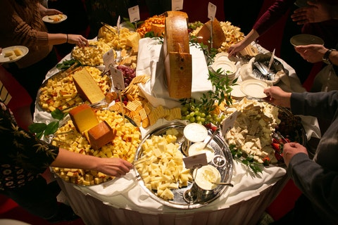 Attendees of the 2020 World Championship Cheese Contest sample the top 75 cheeses of the competition Thursday evening at the Monona Terrace in Madison. (Photo by Sharon Vanorny)