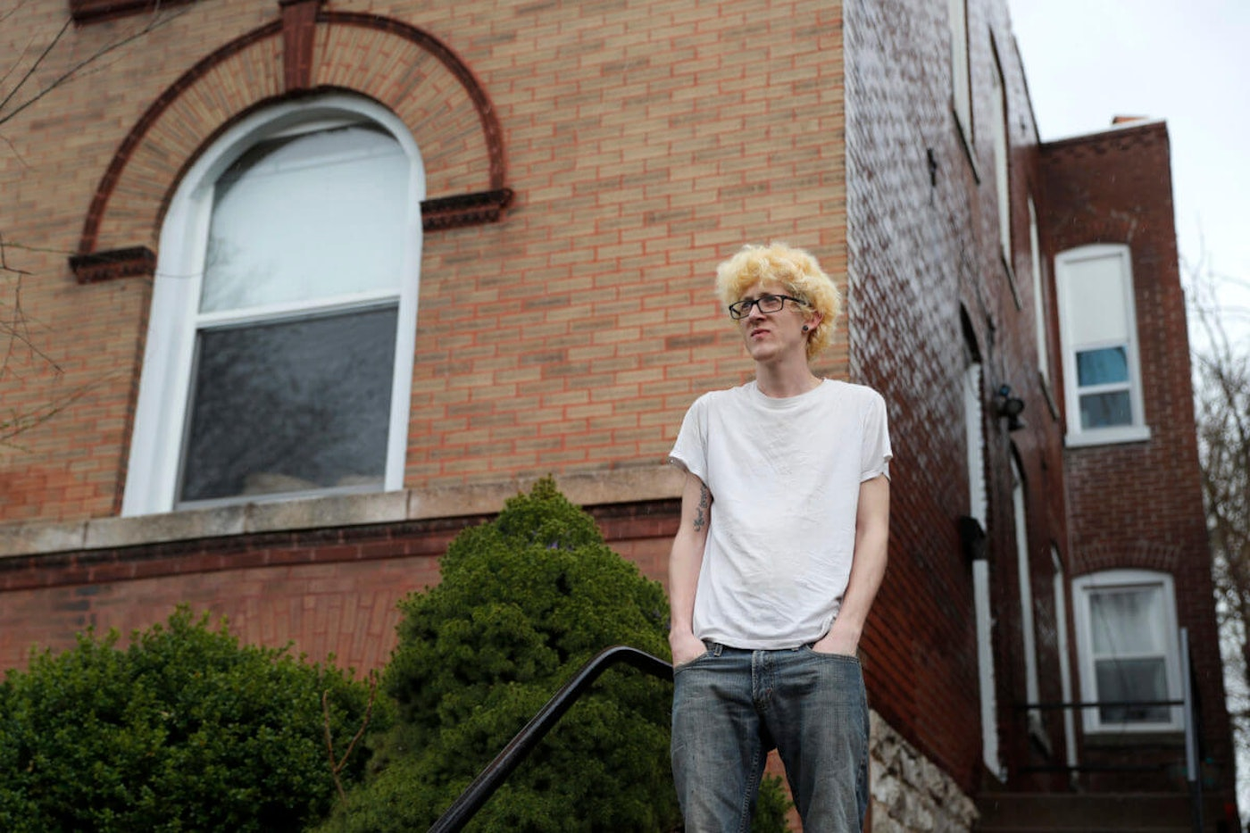 Kyle Kofron poses for a photo outside his home in St. Louis. Kofron is advocating for a rent strike during the outbreak. (AP Photo/Jeff Roberson)