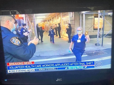 "Footage of Elizabeth ""Buffy"" Riley and other nurses being applauded by New York City police as they departed for work as shown on the ""CBS Evening News"" on Wednesday."