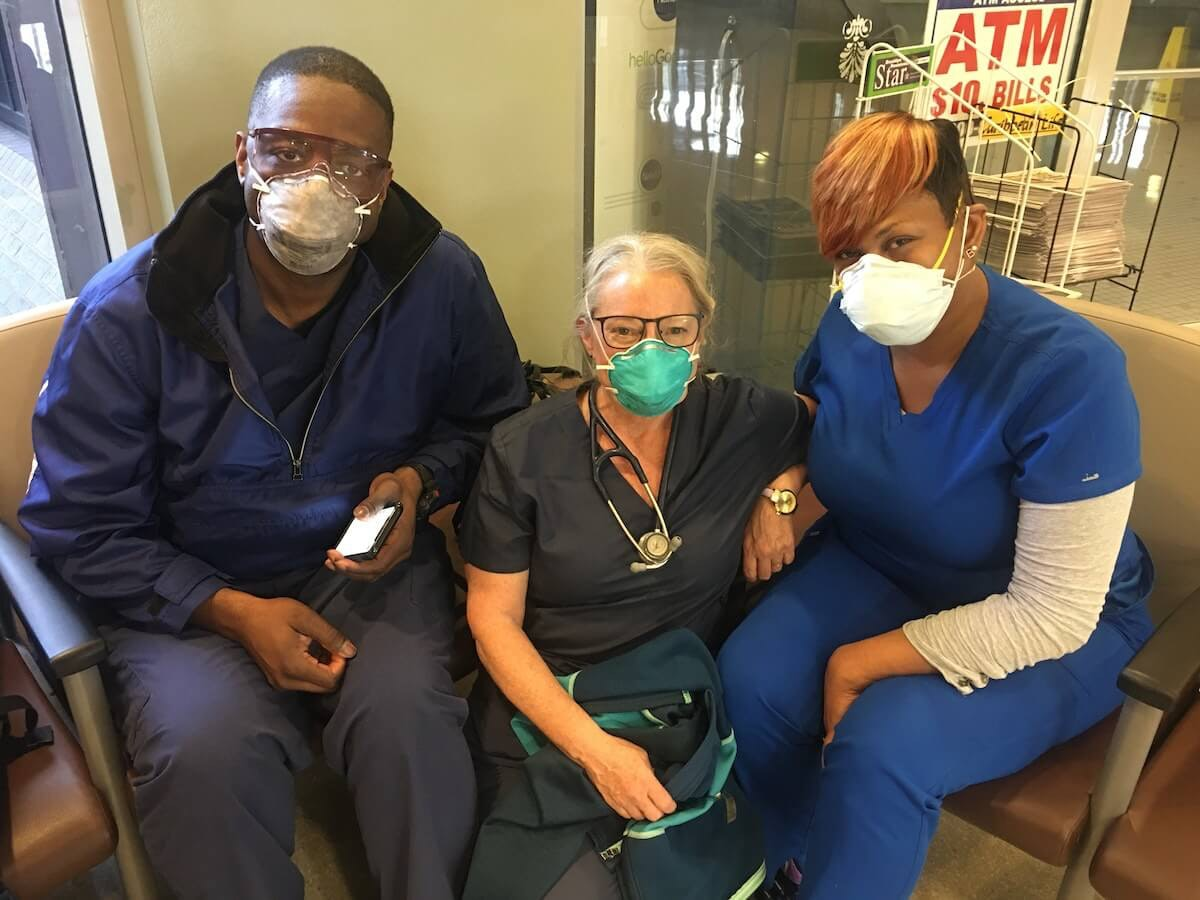 "Wisconsin nurse Elizabeth ""Buffy"" Riley, center, sits with fellow nurses Dee Wells, left, and Benita Conleh, right, in New York. Riley, who lives in Hayward and works in Cumberland, is spending three weeks in New York treating people hospitalized with COVID-19. (Contributed photo)"