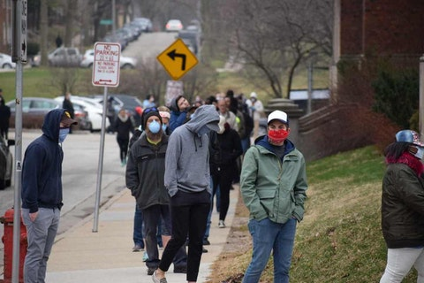 Voters wait in long lines outside one of Milwaukee's five polling places. (Photo by Jonathon Sadowski)