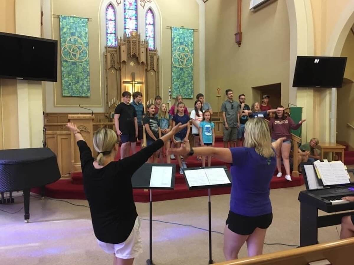 """Members of the vacation bible study group at St. John's Lutheran Church in Eau Claire practice before gatherings at Wisconsin churches were banned by Gov. Tony Evers' """"Safer at Home"""" order. Many churches are conducting services via computer now, but some have proposed hosting Easter worship in church parking lots. (Contributed photo)"""