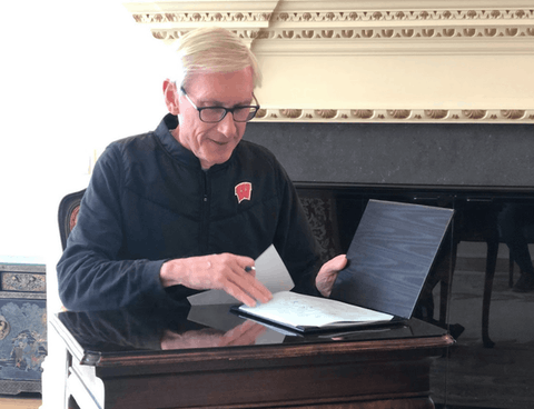 Gov. Tony Evers seen signing the COVID-19 Relief bill in April. An effort to recall Evers failed to move forward Monday, lacking adequate signatures. (Photo provided)