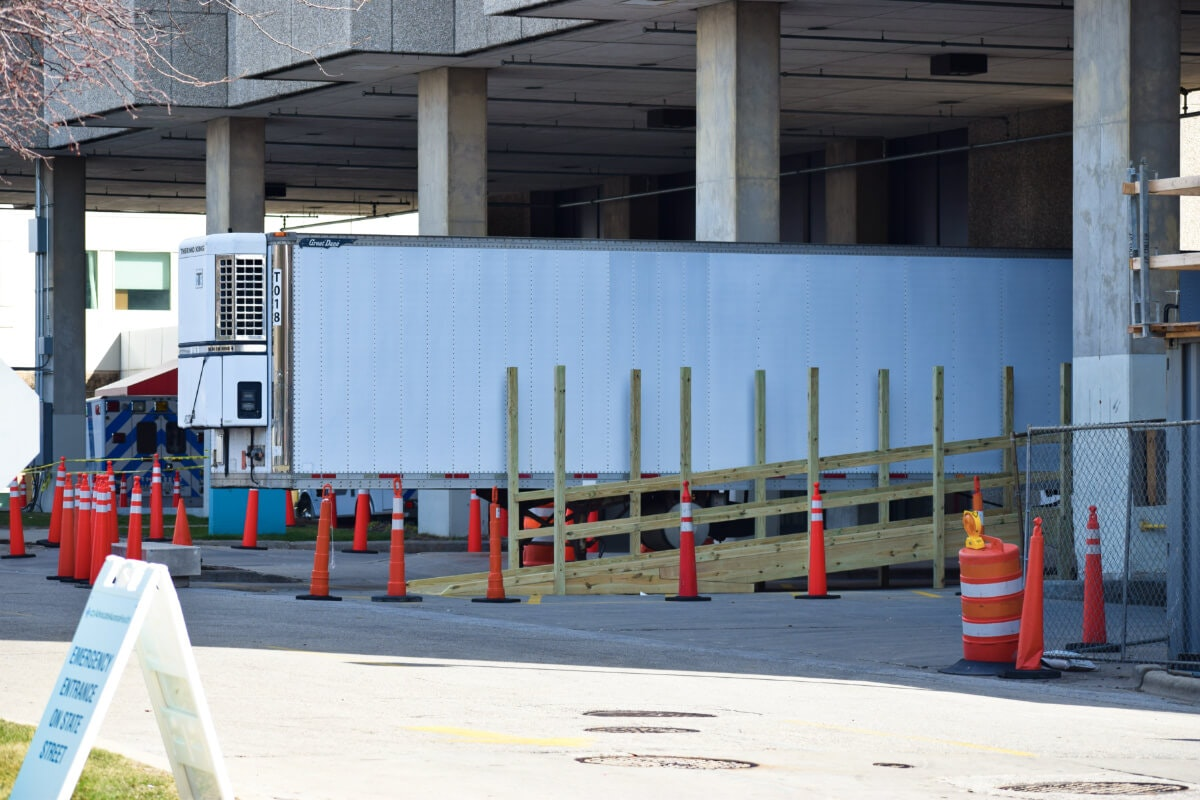 A refrigerated truck has been brought to Aurora Sinai hospital in Milwaukee as a temporary morgue during the coronavirus outbreak that has killed 56 people in Milwaukee County and 100 statewide. (Photo by Jonathon Sadowski)