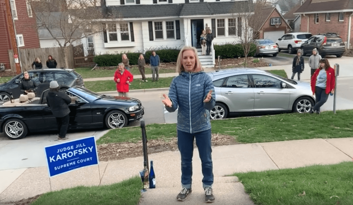 Justice-elect Jill Karofsky declares victory Monday evening outside her home with friends maintaining a social distance. The Dane County judge won a 10-year term on the Wisconsin Supreme Court by unseating conservative incumbent Justice Dan Kelly.