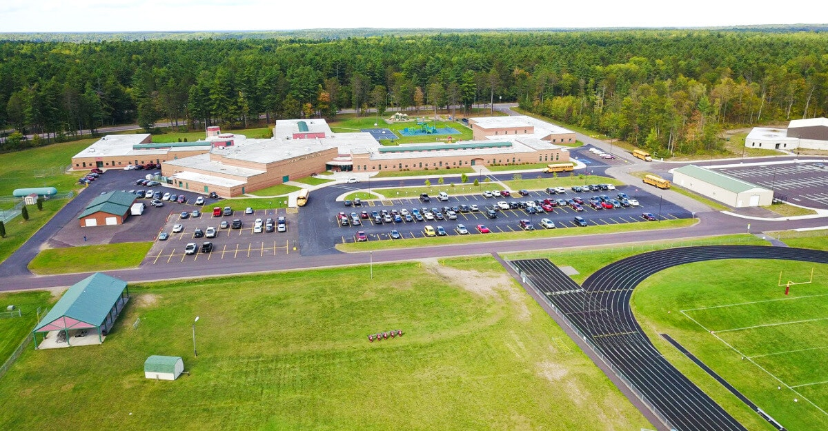 The coronavirus crisis has stopped graded learning at schools across Wisconsin. Shown here is Lac du Flambeau Public School, which is surrounded by patchy cellphone service and few internet options, making equitable, graded virtual learning impossible. (Photo via Lac du Flambeau Public School/Facebook)