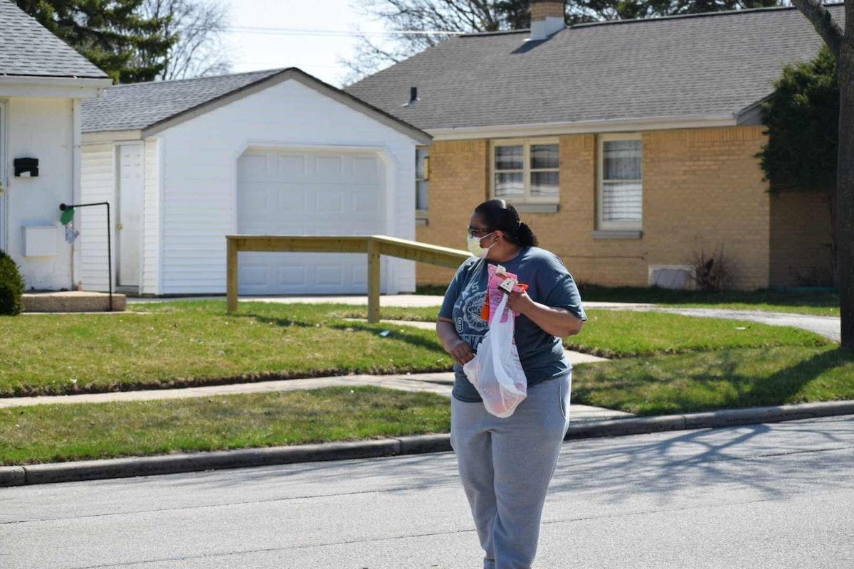 Melvette Scott, of West Milwaukee, hands out bandanas Tuesday at Marshall High School in Milwaukee. (Photo by Jonathon Sadowski)