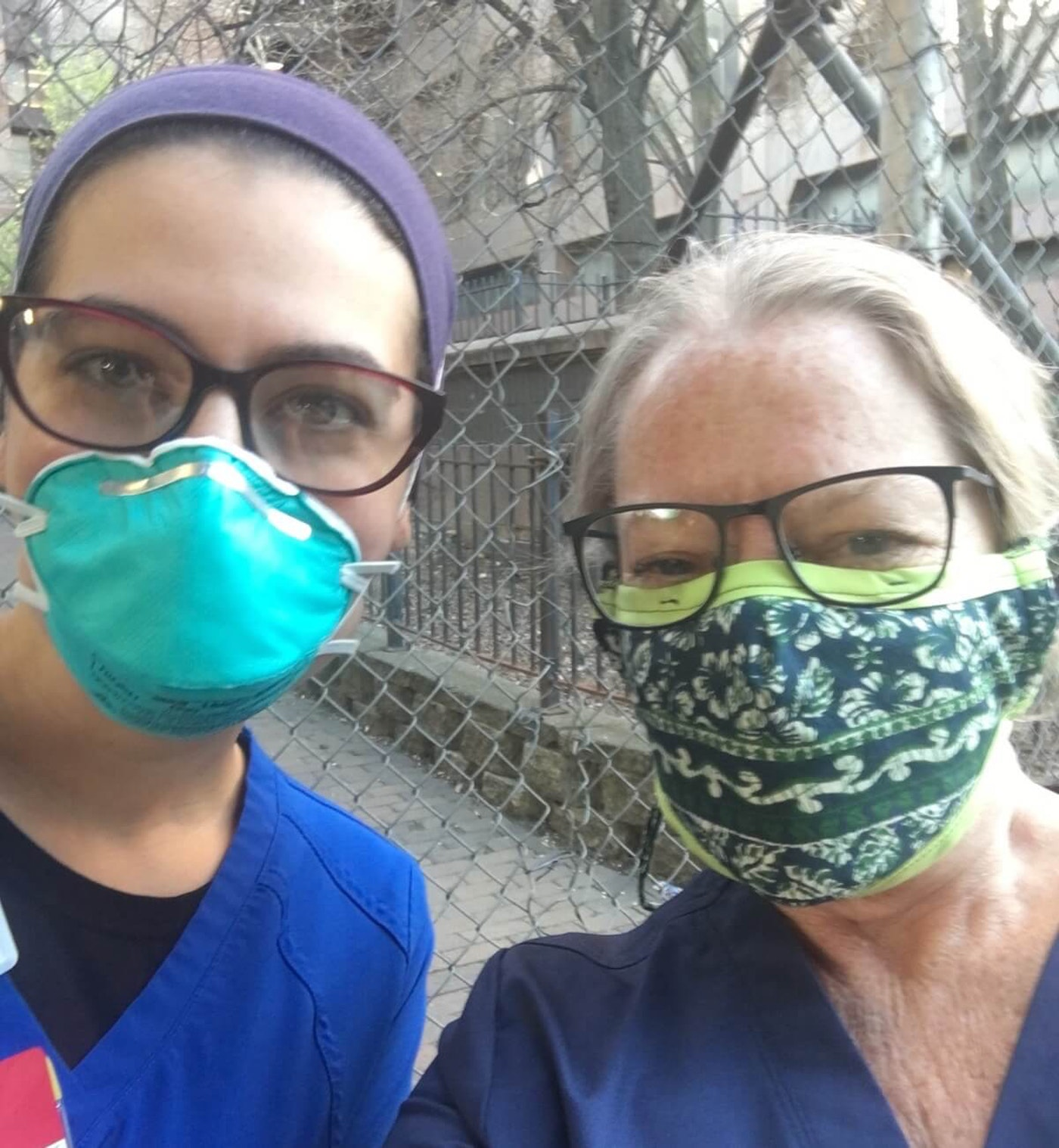 Hayward resident Buffy Riley, right, has given out dozens of N95 masks she has been sent by Wisconsin friends to other nurses working with her in New York. Riley wears two masks and a face shield to protect against her getting COVID-19. (Contributed photo)