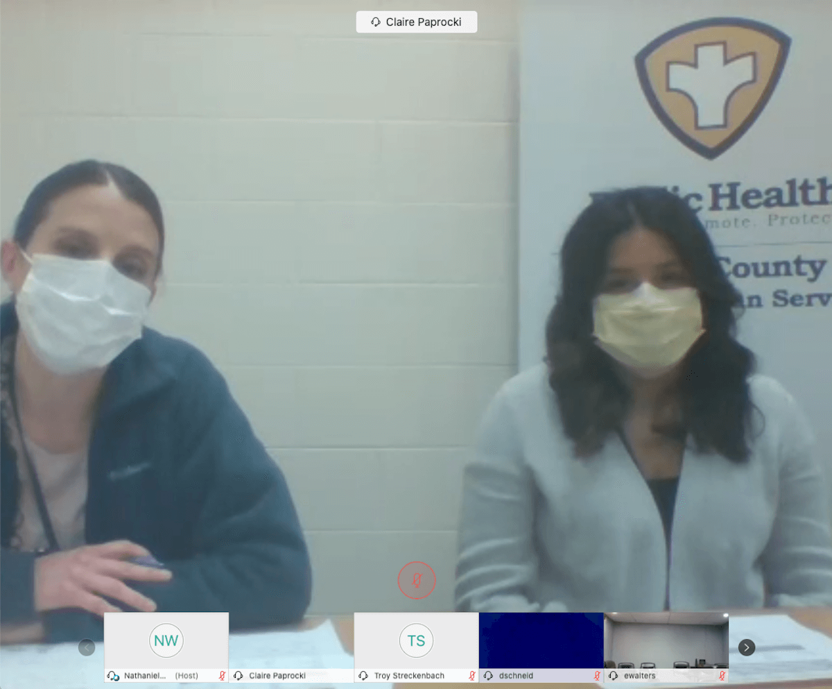 Brown County Public Health Officer Anna Destree, left, and Public Health Strategist Claire Paprocki sit close to one another during a Monday press conference.