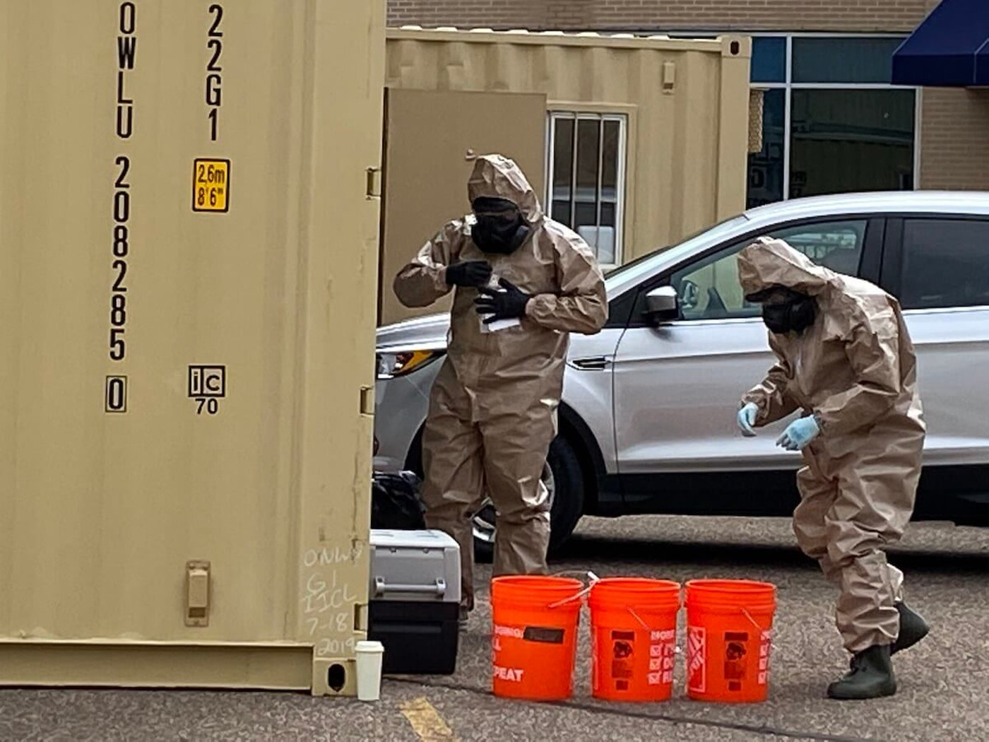 National Guard members conduct COVID-19 tests for attendees at a testing event Sunday in Eau Claire.