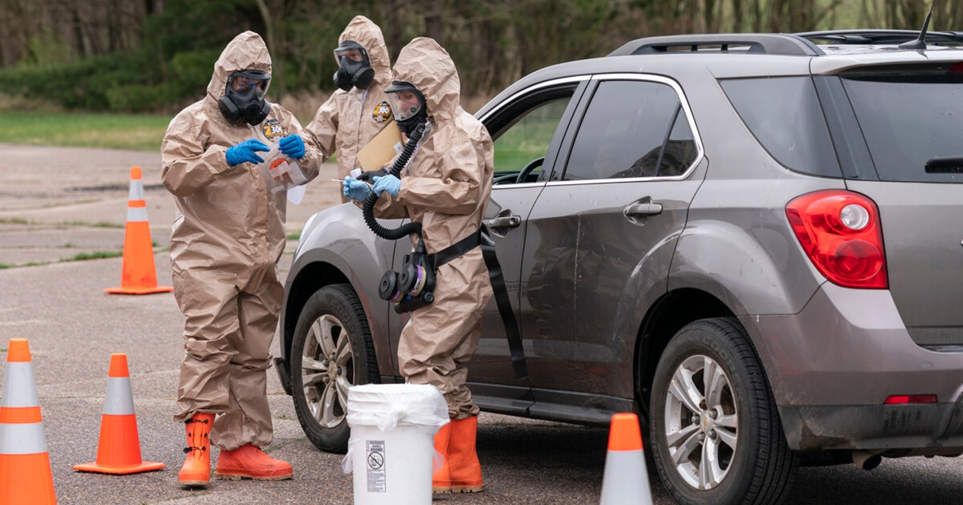 Wisconsin National Guard members Sgt. John Clark, left, and Spc. Madeline Westrick gather samples at a drive-up COVID-19 testing site near Baraboo on April 29. The guard continues to play a key role by running free testing sites across the state as cases surge. (Photo © Andy Manis)