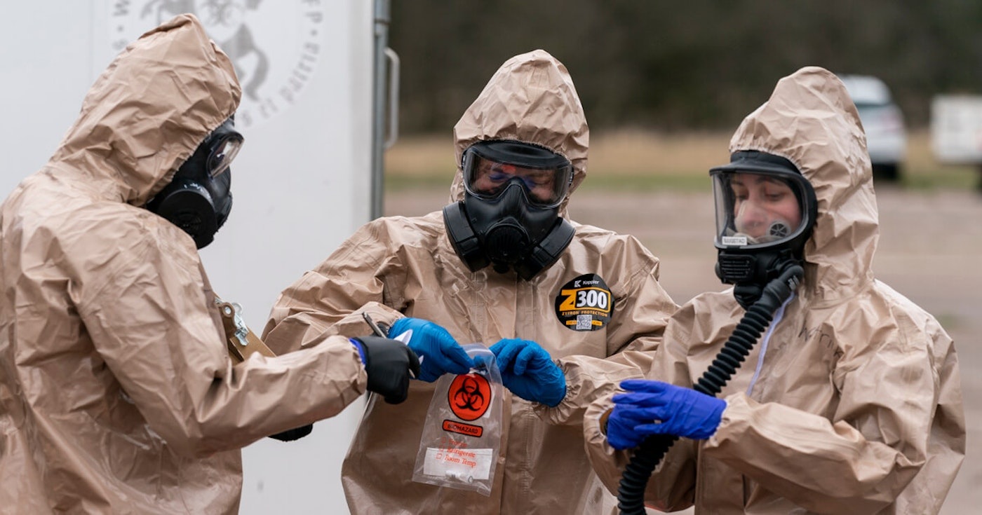 Wisconsin National Guard members Sgt. Nathaniel Nyquist, left, Sgt. John Clark and Spc. Madeline Westrick gather samples at a drive-up COVID-19 testing site near Baraboo on April 29. (Photo © Andy Manis)